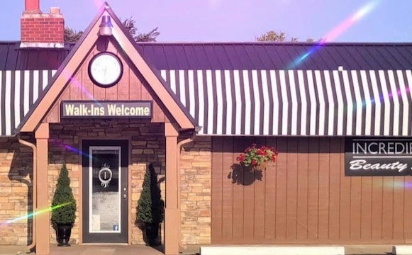 Brick office building with sign reading Incredible You Beauty Studio and prismatic effect overlay